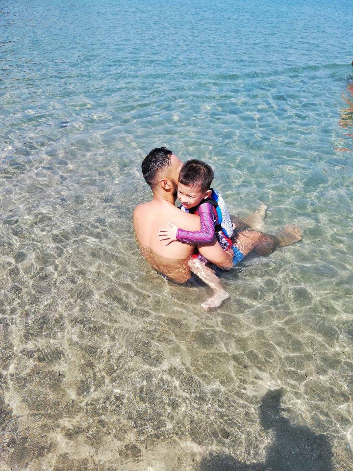 Darel James and Rafa at the beach